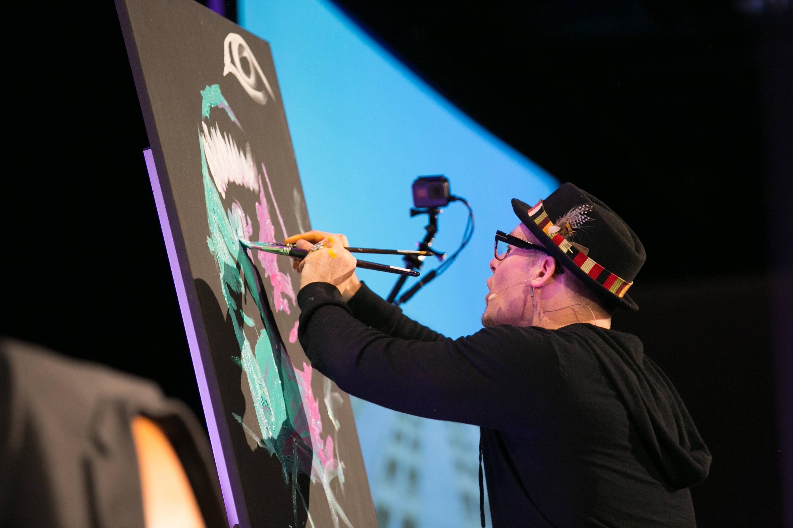 erik wahl painting a picture of albert einstein at a watermark event