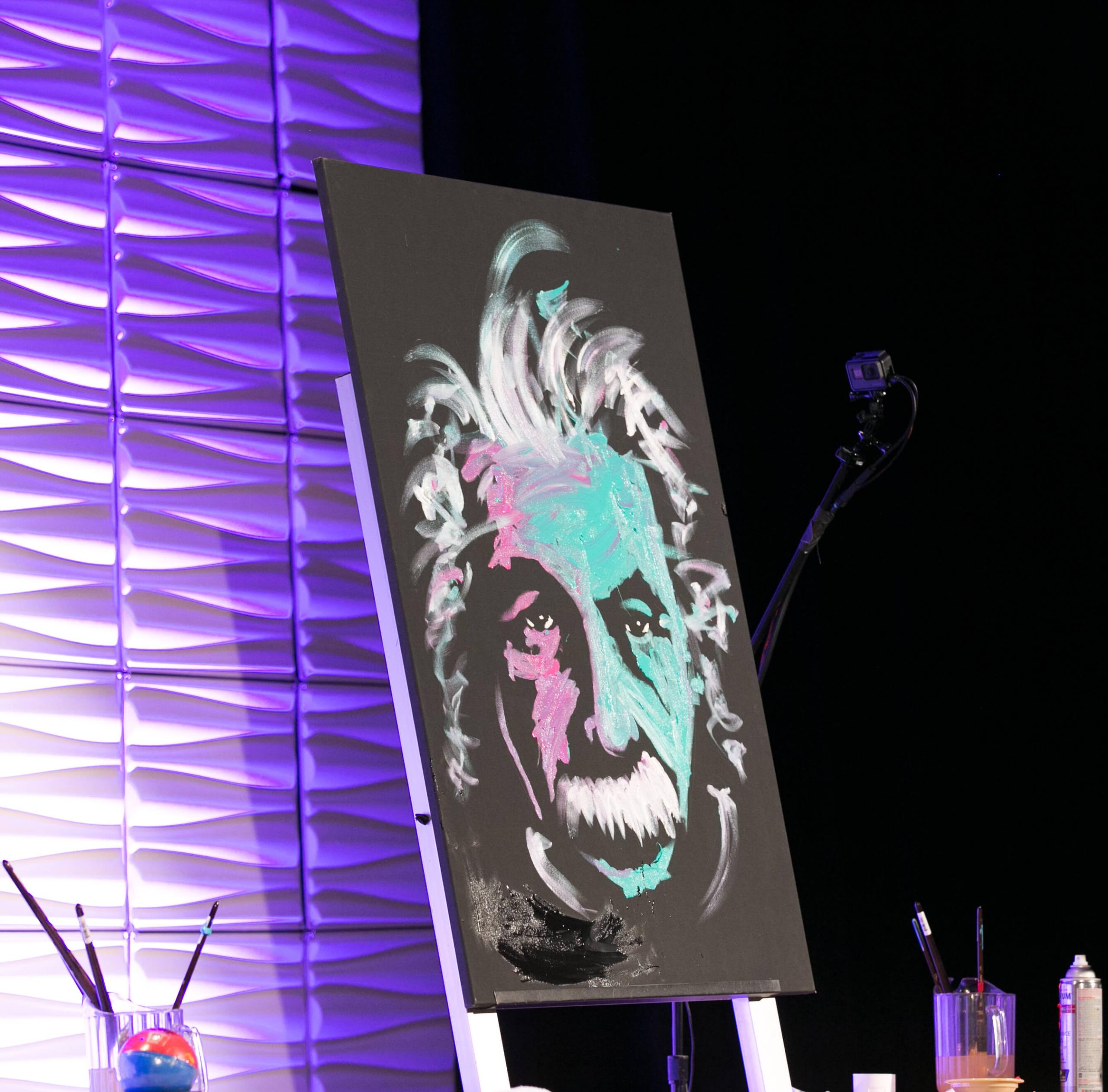 an einstein painting at a watermark event