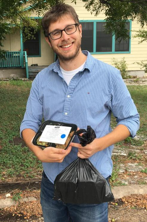 Taskstream-Tk20 employee prepares to deliver meals to Central Texans who are in need.
