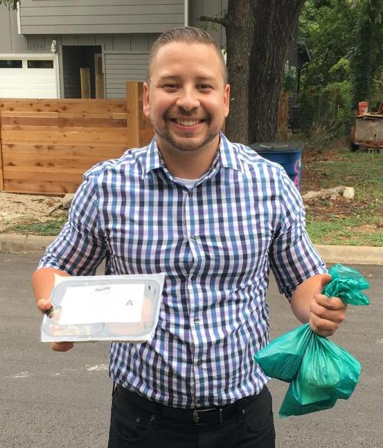 Jermaine Hernandez, Taskstream-Tk20 Implementation Consultant, prepares to deliver meals to Central Texans in need.