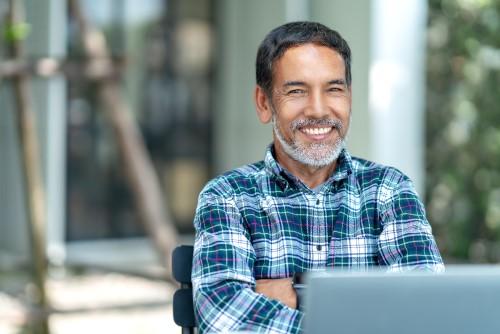 man in a plaid shirt smiling